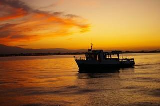 Bon cadeau pêche en mer coucher de soleil